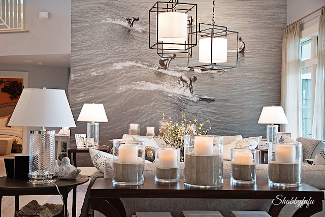 Details in the living room of the HGTV Dream Home 2016. This full-wall vintage black-and-white photo of a surfer is the biggest statement piece in the room and grabs your attention.