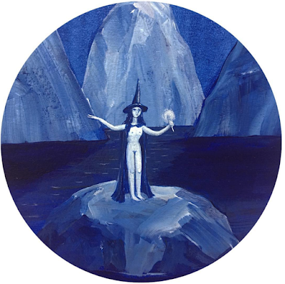 Painting of a peaceful blue nighttime scene; a woman stands on a rock in a dark body of water. The woman is nude save for her pointy hat and black cloak. She is holding a wand and raising her hands to cast a spell. High above her, the moon is distant but immaculately bright.