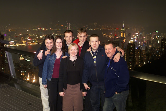 group photo in front of Hong Kong skyline