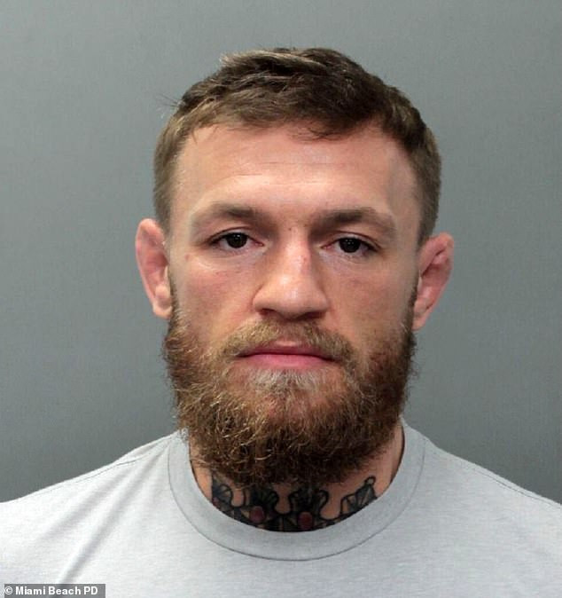 UFC star Conor McGregor arrested in Miami for 'smashing a fan's phone out of his hand and stomping on it