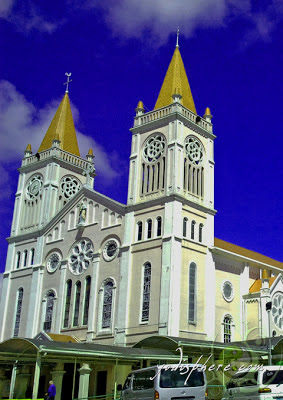 Photo of facade of Baguio Cathedral showing its twin spires