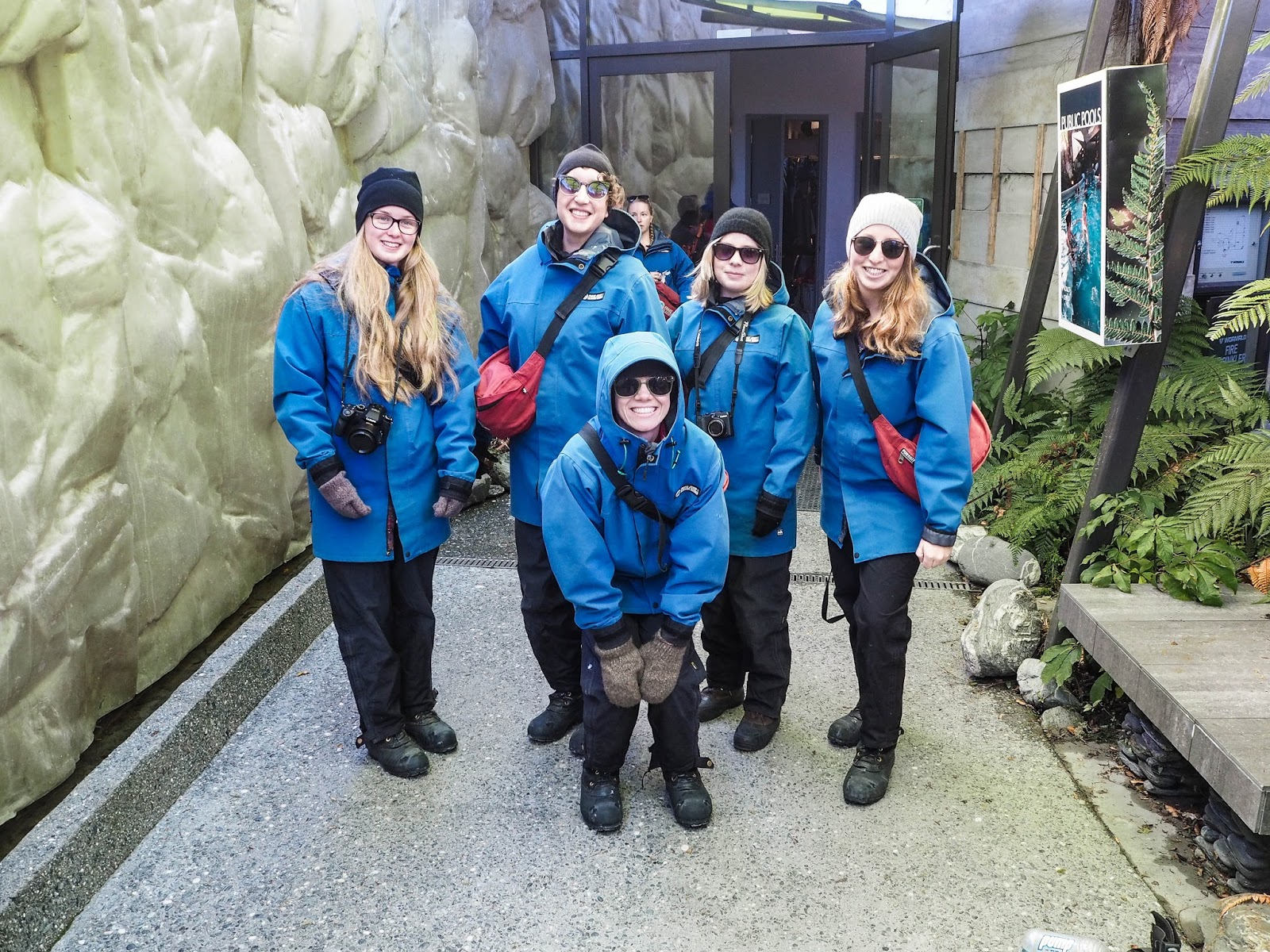 Tourists in snow proof clothing in preparation for hiking Franz Josef glacier