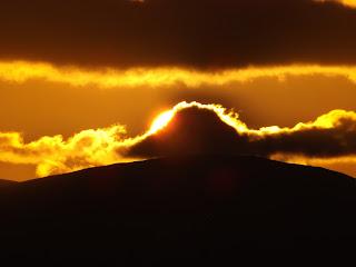 Naplemente: a felhők mögött