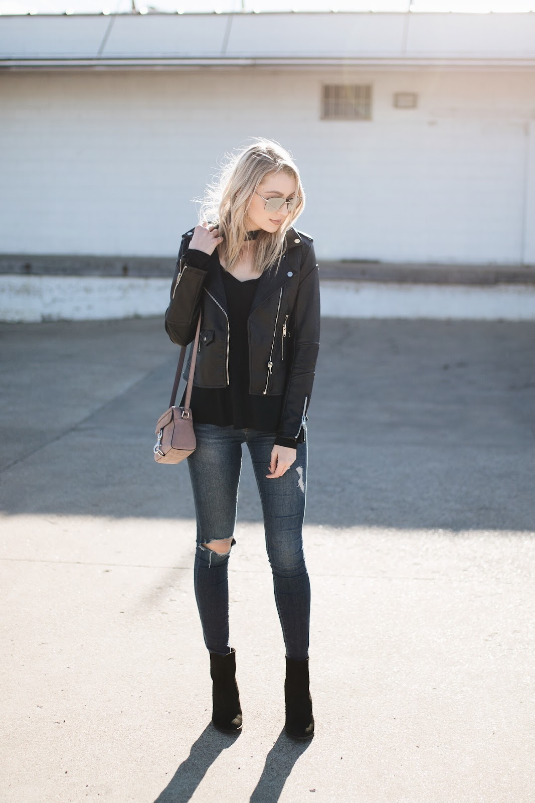 Faux leather jacket, ripped jeans, ankle boots
