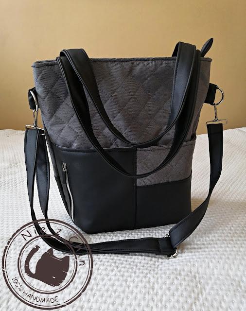 Pikowana torebka z wieloma kieszeniami