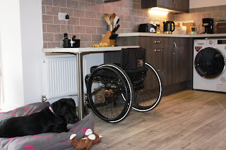 Picture of lowered section of worktop with food ready to prepare and wheelchair