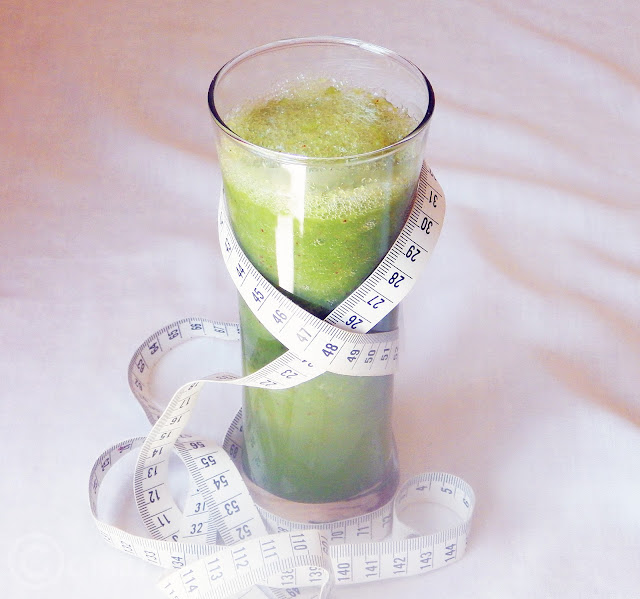 A Glass of Celery Juice with a tape measure around it