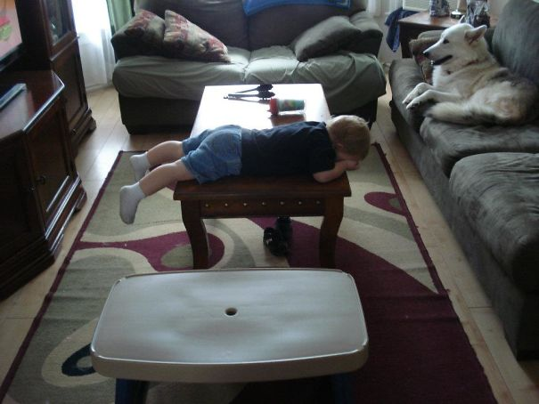 15+ Hilarious Pics That Prove Kids Can Sleep Anywhere - Sleeping On The Coffee Table