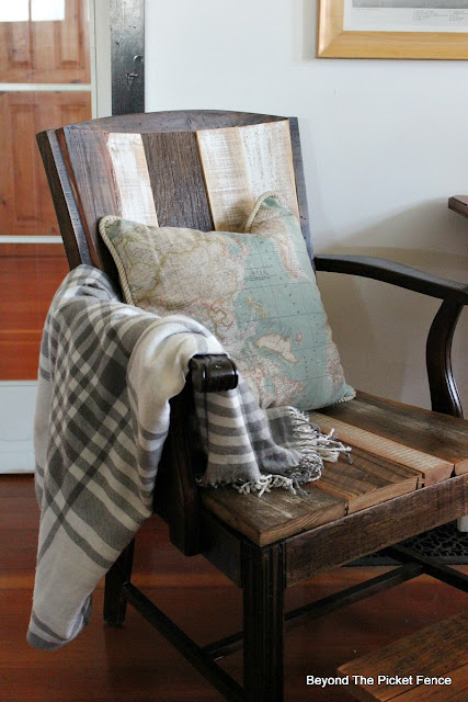 Use barn wood and pallet wood to upcycle a vintage chair