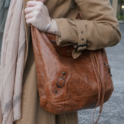 camel trench coat and Balenciaga truffle brown RH classic day bag on shoulder | away from the blue