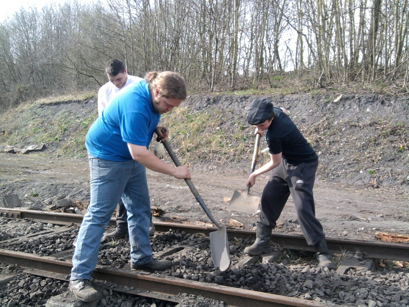 Owen leads youth team members Adam and Anthony in levelling ballast at East Tanfield curve