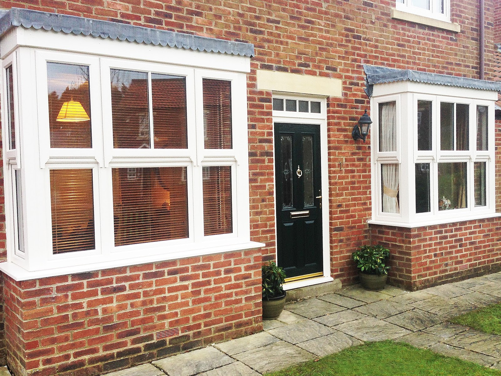 Full house of box sash bay windows with beautiful green for Box bay window