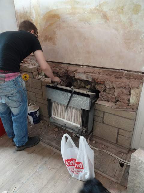 removing bricks around a fire