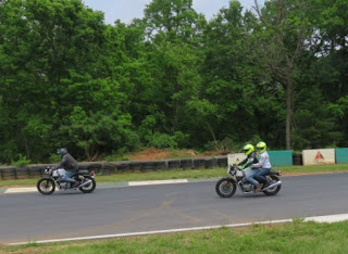 Motorcycle riders including one with a passenger.