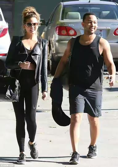 Pregnant Chrissy Teigen hits the gym with hubby John Legend