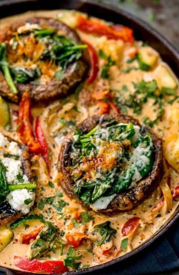 Tuscan Style Stuffed Mushrooms in Creamy Sun Dried Tomato Sauce