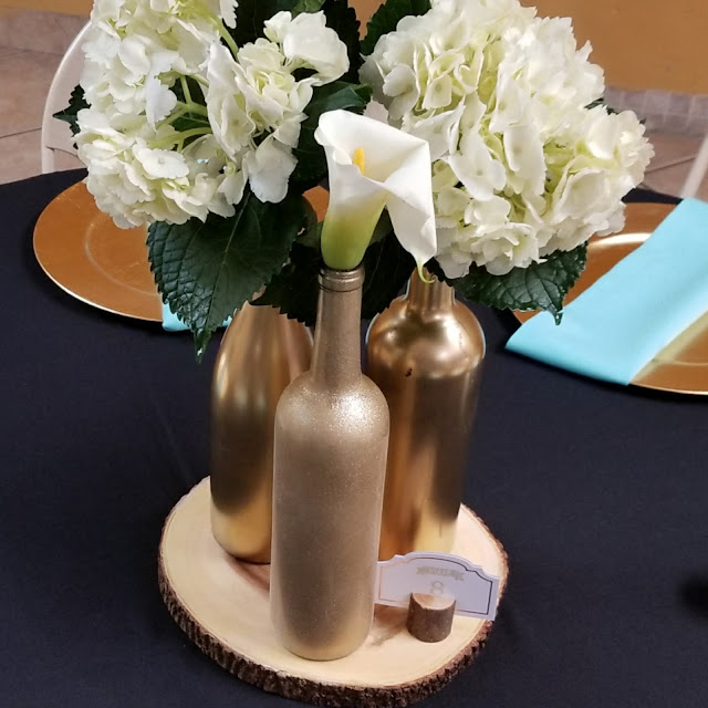Easy to create wine bottle centerpieces that sure to impress your guests.
