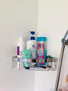 organised corner shelf in bathroom