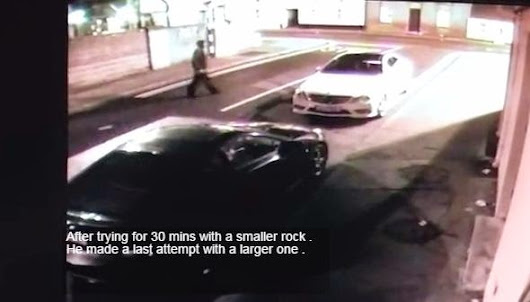 Video: Man tries to break a car window with a stone in the face Verde ~ Best Modern Cars