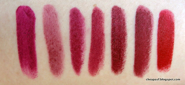 Swatches of Wet N Wild Sugar Plum Fairy, Revlon Balm Stain in Crush, Paula's Choice Plum, Bite Mulberry, Bite Scarlet, Maybelline Creamy Matte Divine Wine, and Urban Decay Matte Bad Blood