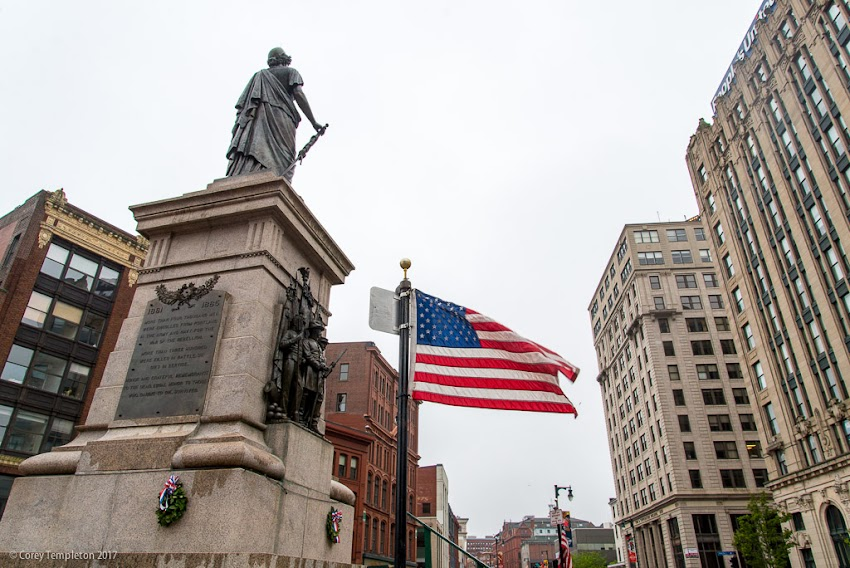 Portland, Maine USA May 2017 photo by Corey Templeton. The Our Lady of Victories statue and American Flag in Monument Square on Memorial Day.