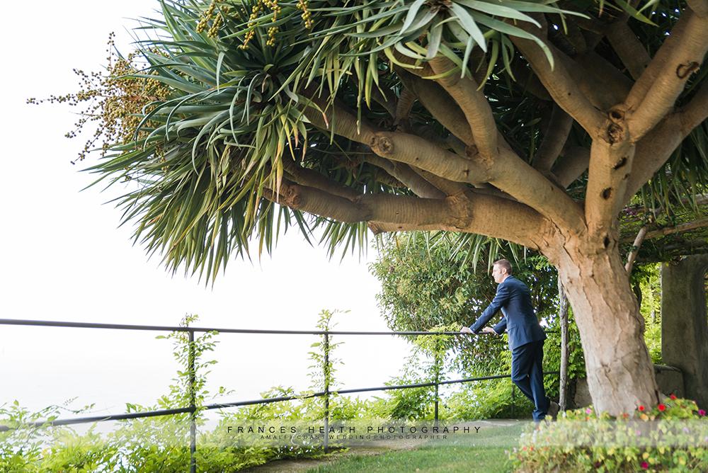 Groom underneath large tree
