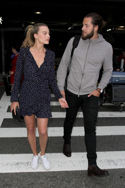 Margot Robbie With Tom Ackerley Arrives at LAX Airport in Los Angeles