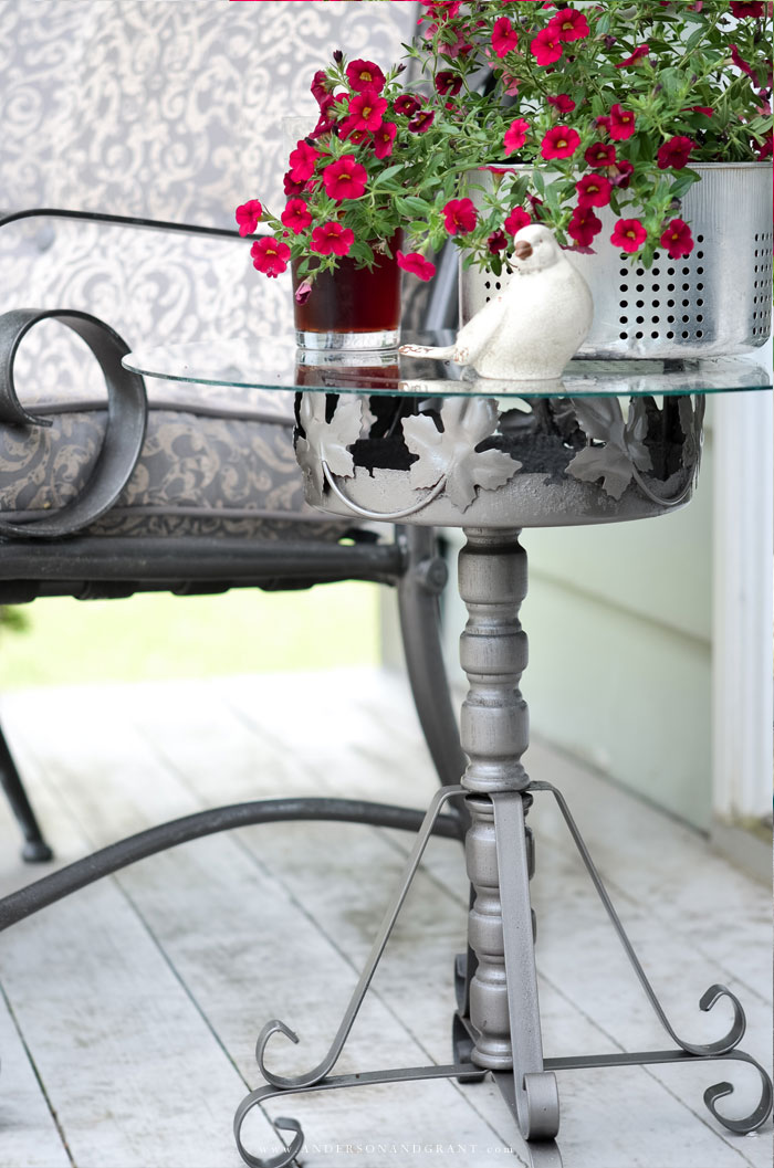 A must see DIY.....this outdoor table is made from a rusty plant stand!  #DIY #repurposed #DIYtable #outdoorprojects