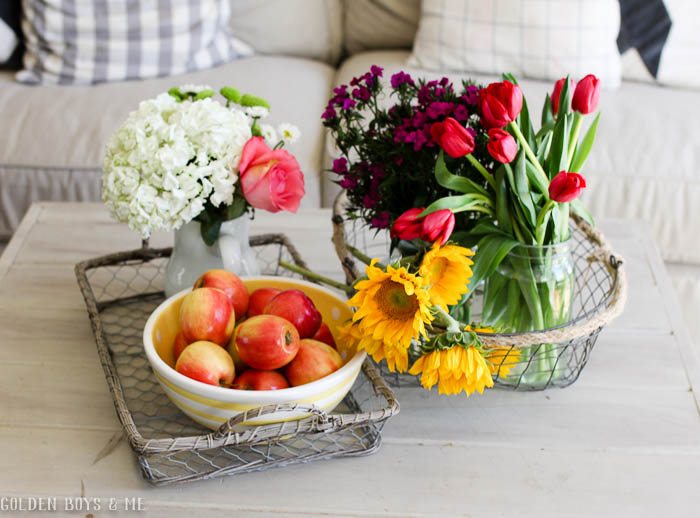 Spring flowers and apples in kitchen seating area