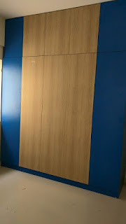 Wardrobe in Laminate and machine pressed edge banding