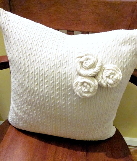 White sweater with rosettes from the sweater