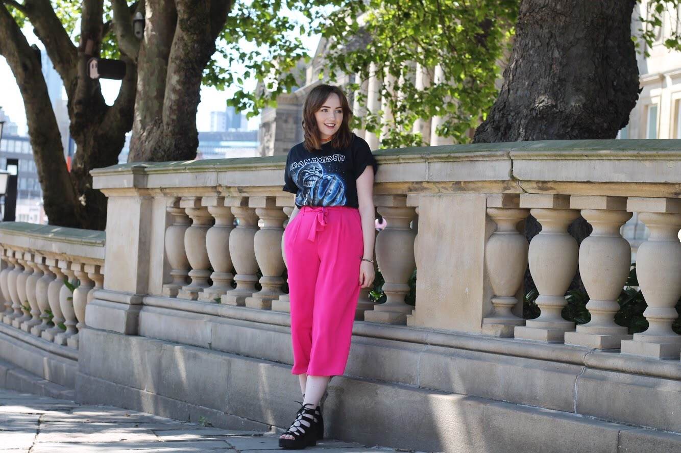 outfit at british style collective 2017 from liverpool fashion blog with black iron maiden t shirt, silver bag, pink culottes and black lace up chunky shoes