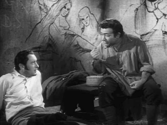 George Sanders and Akim Tamiroff in A Scandal in Paris (1946)