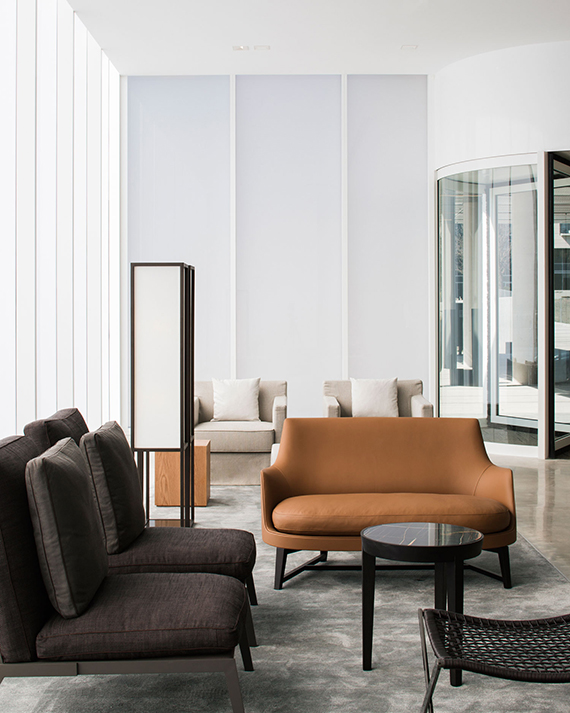 Tan leather sofa | Little National Hotel Canberra by Redgen Mathieson Architects