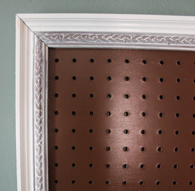painted pegboard and decorative moulding
