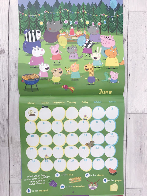 Open Peppa Pig calendar showing the characters