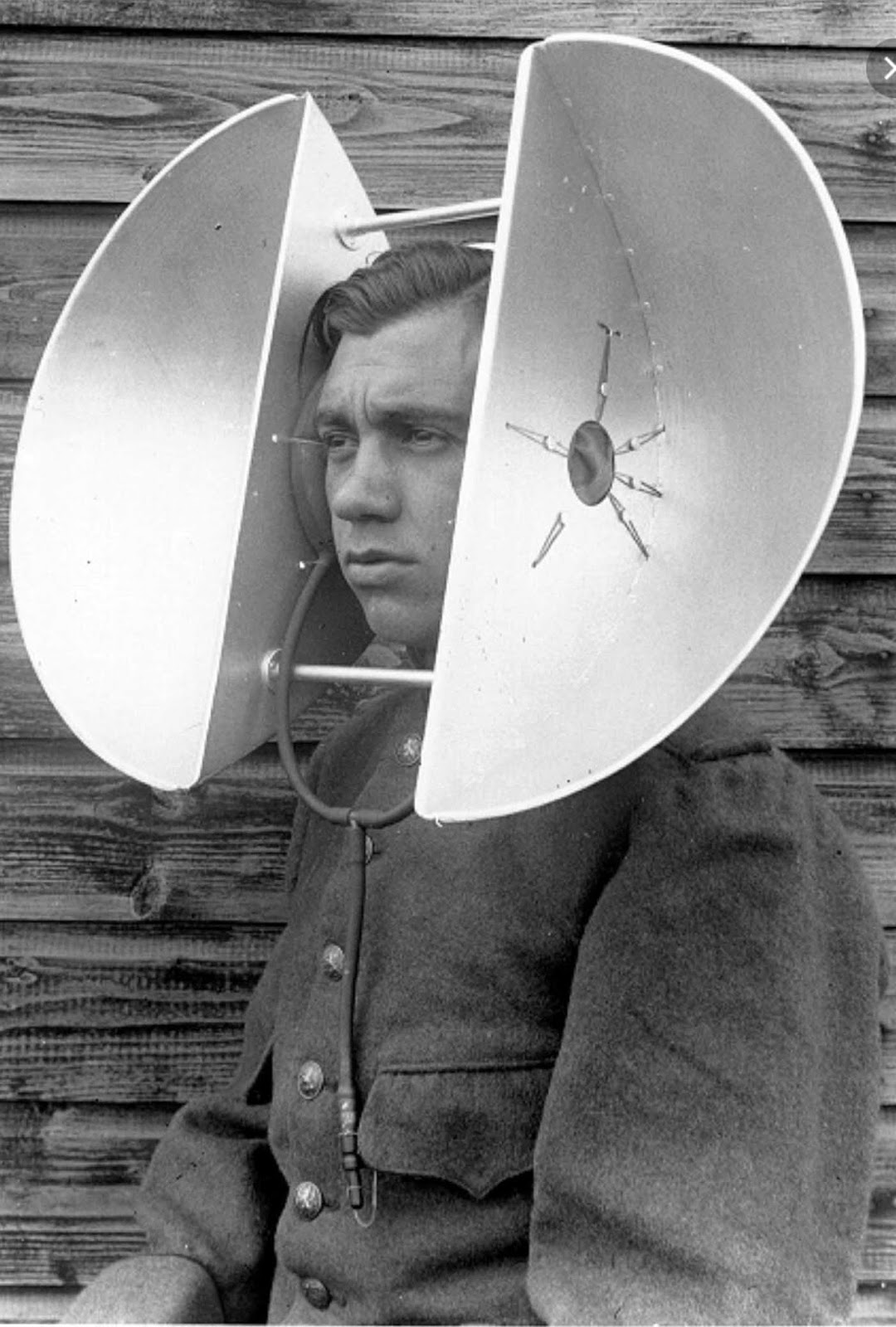 The Dutch personal parabola, 1930s.This personal sound locator consists of two parabolic sections, presumably made from aluminium for lightness. They are mounted a fixed distance apart, but the size of the human head varies somewhat. To accommodate this, it appears that the instrument is fitted with inflatable ear-pads. According to a report dated 1935, this device was put into at least limited production.
