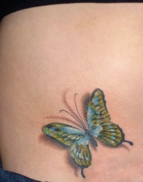 Colorful 3D butterfly tattoo on belly