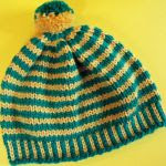http://www.cascadeyarns.com/patternsFree/C242_BandingTogetherHatMittens.pdf