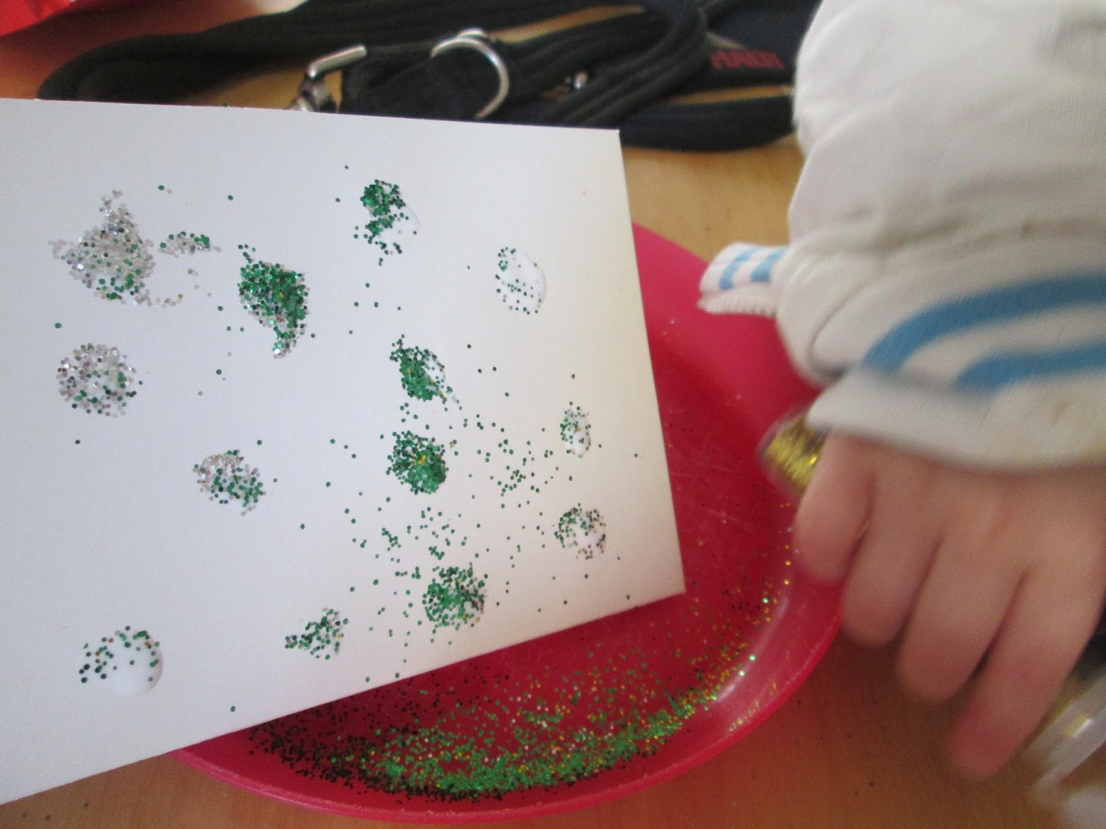 Alexander's card and trying to catch the glitter