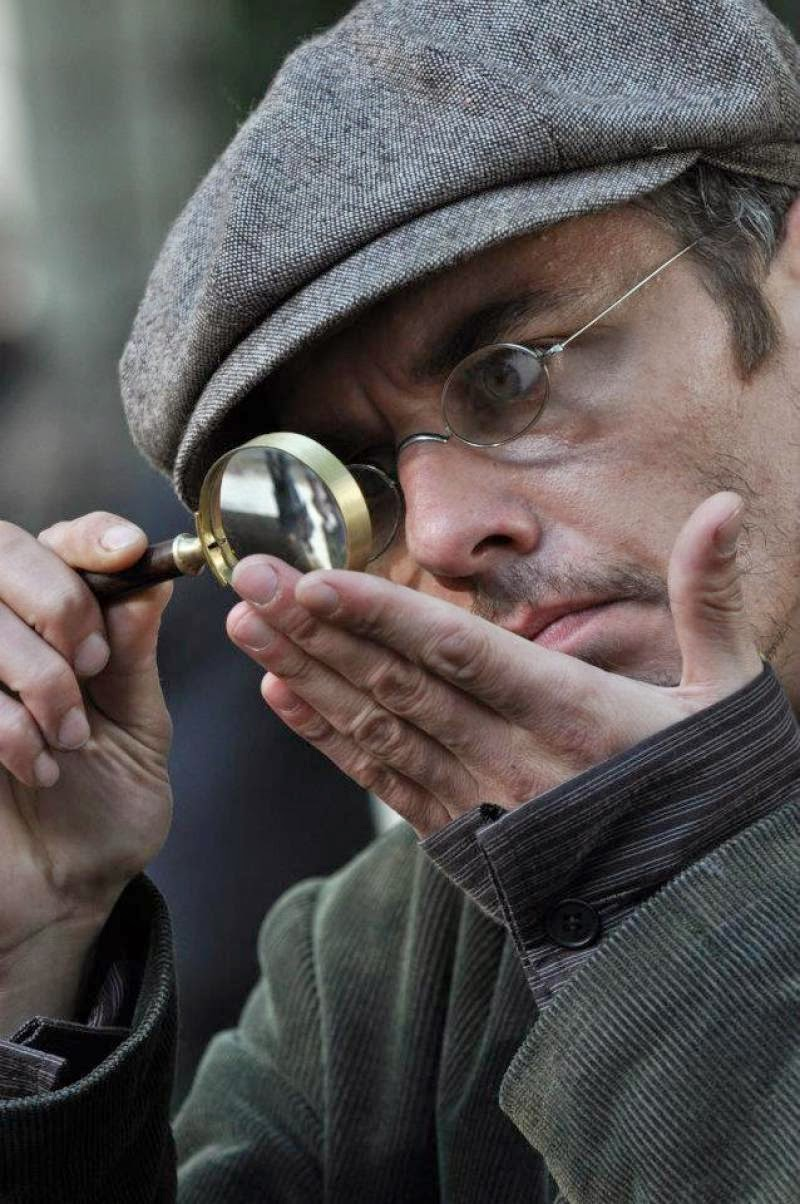 Russian Sherlock Holmes Igor Petrenko using magnifying lens in the new Russian Sherlock Holmes 2013 TV Series