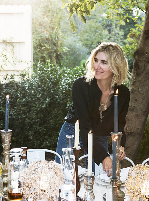 Amy Neunsinger styling a beautiful table outdoors