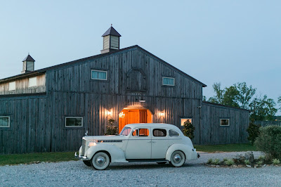 Rustic barn wedding meets vintage fairy tale. Meadow Creek Farm North Alabama wedding venue. Vintage Beauty and the Beast inspired wedding reception decoration ideas. Vintage get away car
