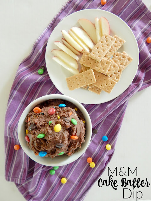 M&M Cake Batter Dip...this dip of your dreams!  Creamy, rich chocolate studded with M&M's.  Dip with sliced fruit or graham crackers and it will be the party hit! (sweetandsavoryfood.com)