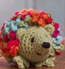 http://www.redheart.com/free-patterns/harper-hedgehog