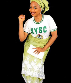 Female Corper rocks her NYSC uniform with wrapper
