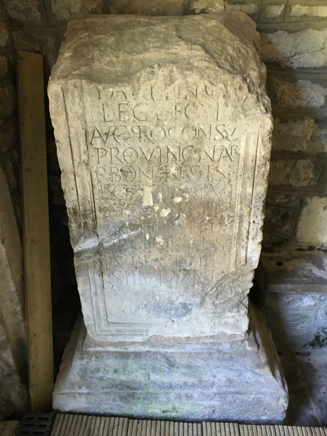 Roman stone with words carved into it