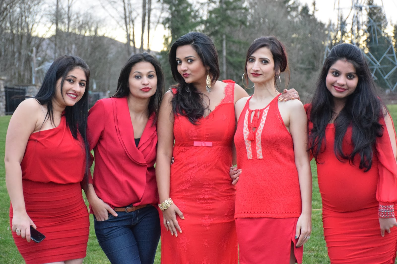 gals all wearing red dress, group pic of indian gals, different types of red dresses, Seattle indian ladies, red lipstick on brown skin