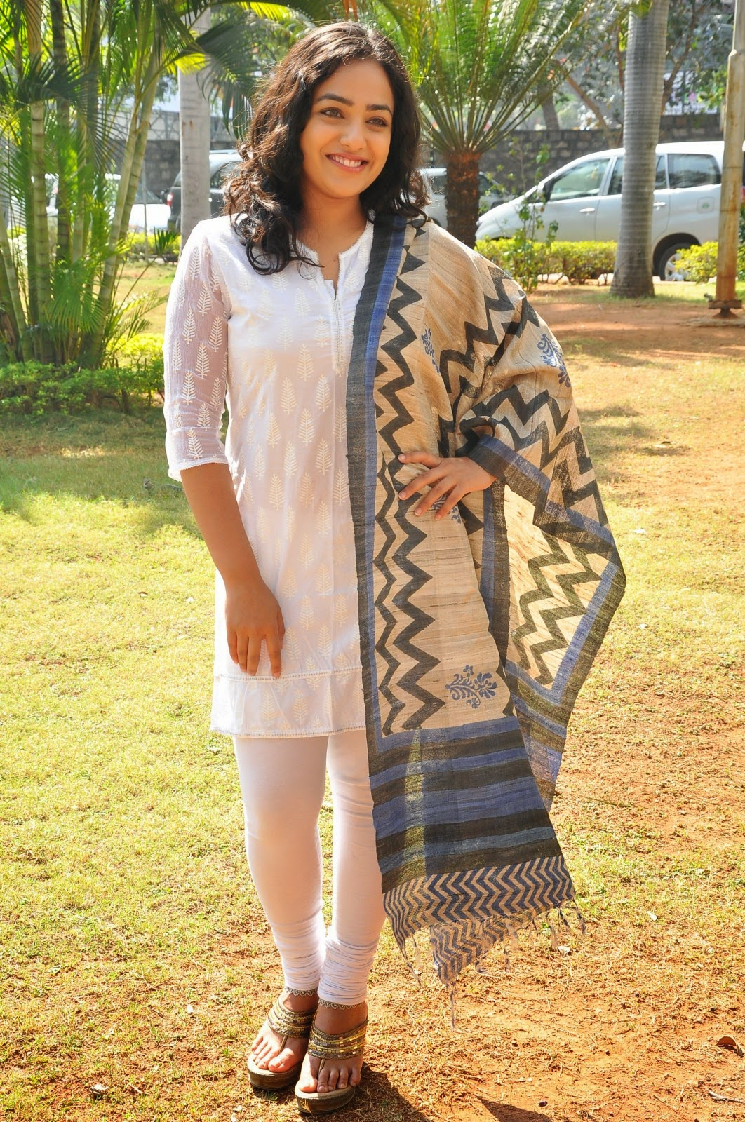 Nithya Menon Hot Smiling Big Teeth Face Stills