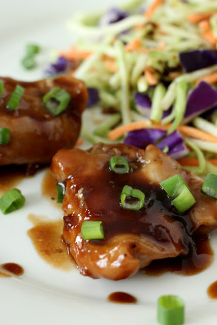 Orange Ginger Chicken topped with sauce and chopped green onions